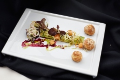"""Salad - baby greens on an avocado """"marble;"""" Champagne vinegar and grapeseed oil vinaigrette; salad of daikon, radish and cucumber; roasted beets; compressed cantaloupe melon with honey and thyme; """"sparkling"""" green grapes; cilantro and mini gougères."""