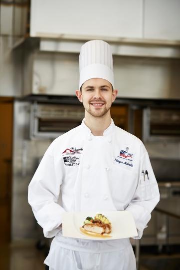 "Chef McCrady's winning dish: pan-seared chicken breast, chicken reduction, potato ""bar,"" glacé carrots, pickled beets, sautéed mushrooms and broccoli three ways."